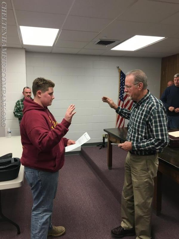Kevin Morrissy being sworn in by his grandfather Harry Morrissy.